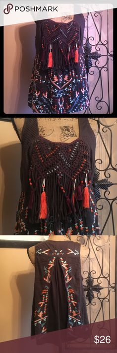 "Unique Akemi + Kin Top Very detailed brown cotton linen top with a very detailed crochet style braided bust w blue, orange & purple cross stitch accents & long drape w maroon & orange tassels. Boho bottom embroidery in matching colors. Pleated shoulders & sides. Open tunic style drape in the back. Sz L from Anthro like new loose 38""+ bust & 24"" length. Too many amazing details to list!! Anthropologie Tops Tunics"