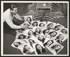 Citation: Alberto Vargas with photographs of models for the Jayhawker Annual at Kansas University, 1943 / unidentified photographer. Alberto Vargas papers, Archives of American Art, Smithsonian Institution.