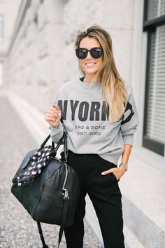 Black Trousers With A Graphic Sweatshirt
