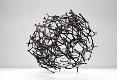 Small decorative ball made out of chicken wire & red resin. madebymanos, etsy