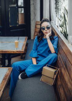 Monochrome Trend, Street style fashion blogger influencer Jenny Tsang of Tsangtastic wearing VICTORIA VICTORIA BECKHAM Victoria Pant, VICTORIA VICTORIA BECKHAM Trumpet Sleeve Top, LAUTEM I Got Rhythm Bag, VINCE Platform Sneaker, in Los Angeles, California.