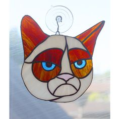 Some kitties are just grumpy! This little sun catcher features a grumpy little kitty who may be just having a bad day. Crafted in the copper