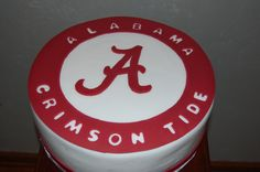 """From Cake Central. Uploaded by sncakes, who said: """"This turned out to be a huge cake.  12"""" cake pan and 4 1/2"""" tall. Cake covered with fondant.  It was done for someone signing up to play football with the Crimson Tide."""""""