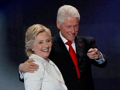 Democratic presidential nominee Hillary Clinton stands with her husband Bill Clinton (Reuters)