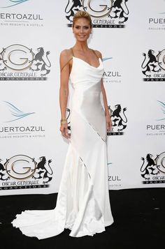 Heidi Klum looking absolutely lovely in a white gown from Versace Fall/Winter 2014.