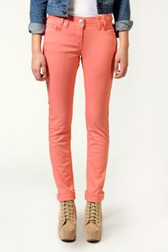 Love the pop of colour in these coral jeans, very feminine.