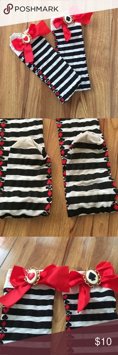 Alice in Wonderland Striped Thigh High Stockings Thigh High. Black and white stripes with card suits along the side. 2 red bows at the top. Some slight discoloration at the bottom foot area. No snags, holes, or piling. Only worn once. Leg Avenue Accessories Hosiery & Socks
