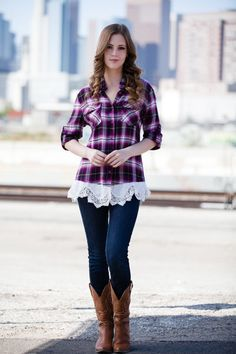 Plaid and lace together! What's not to love about this button up top!! Magenta, black, and white make up this plaid button up top with lace detailing on the bottom hemline. Super soft! Perfect for a c