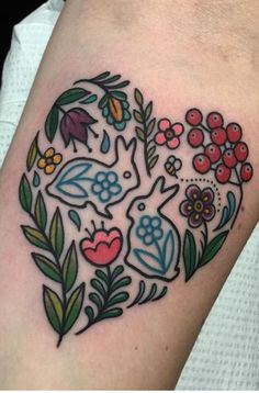 Bunny rabbits and flowers in a heart motif. Traditional tattoo by Mya Oh
