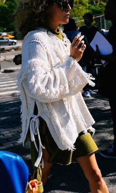 A fringe white oversized sweater with ties