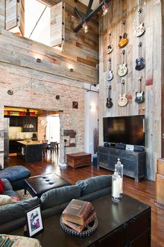 Dramatic weathered wood wall for guitars with exposed brick in a open floor plan space-Besch-Design-Chicago-Loft-6