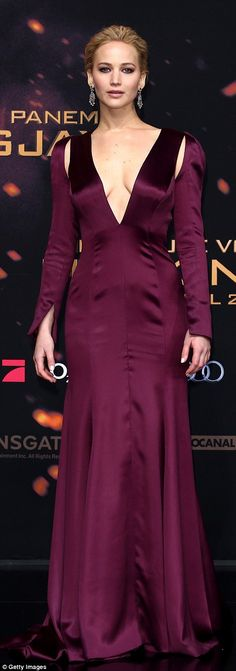Jennifer Lawrence wears a purple Christian Dior Couture gown at the Berlin premiere of The Hunger Games: Mockingjay Part 2.