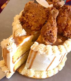 """Well, zoom out a bit, and you'll see that this cake is actually <u><i>way</i></u> out of the ordinary! What looks like frosting is actually mashed potatoes dripping with gravy — and the inside? Layers of moist cornbread. And of course, to top it all off, whole pieces of fried chicken are the delicious crown atop this incredible """"cake."""""""