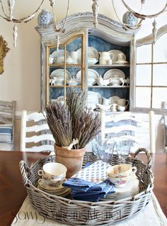 French Country Style: I like how the inside of the cabinet is painted blue. It makes the dishes inside display beautifully! French Country Dining Room, French Country Kitchens, French Country Farmhouse, French Country Style, French Country Decorating, Country Living, French Kitchen, Country Charm, Southern Living