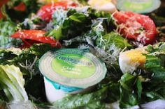 Caesar Salad: Romaine Lettuce, Caesar Dressing, Tomatoes, Hard-Boiled Egg, Croutons, & Fresh-Grated Parmesan.