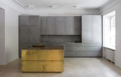 Kitchen in grey Valchromat, concrete and brass. Gold and grey apartment - Designed by Studio Richard Lindvall Brass Kitchen, New Kitchen, Kitchen Decor, Kitchen Grey, Kitchen Island, Kitchen Dining, Kitchen Cabinets, Placard Design, Interior Minimalista