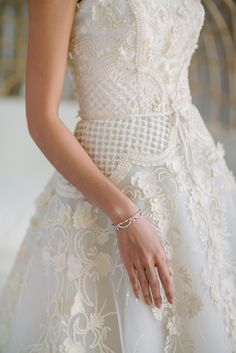 Hand-beaded ball gown: Photography : darinimages Read More on SMP: http://www.stylemepretty.com/destination-weddings/2016/08/25/dreamy-beach-wedding-style-session-at-celebrity-destination/