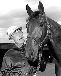 Bret Hanover was a three-time Horse of the Year Winner in 1964-1966. Here, he is pictured with his trainer and driver Frank Ervin.