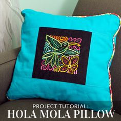 Add bright colors and embroidery to your home with this Hola Mola pillow from Embroidery Library.