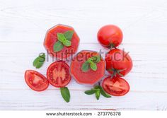 Tomato Juices and vegetables on white wooden table top view Tomato Knife, Table Top View, Wooden Table Top, Knife Photography, Pop Art, Stock Photos, Vegetables, Juices, Wood Desk