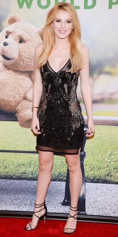 Bella Thorne got glam for the Ted 2 premiere in a LBD featuring beaded embellishments and sheer panels. Delicate black strappy sandals served as her shoe of choice.