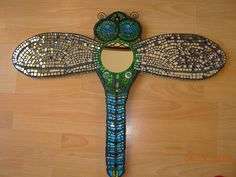 Mosaic Dragonfly mirror by Nikkinella, via Flickr