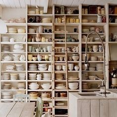 kitchen with shelves of dishes. by vesna deza