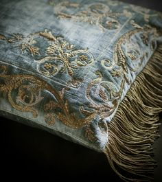 """An opulent design of classical scrolls in richly worked gold thread. Size 50cm x 35cm / 19½"""" x 13½"""" All sizes are approximate and may differ slightly."""