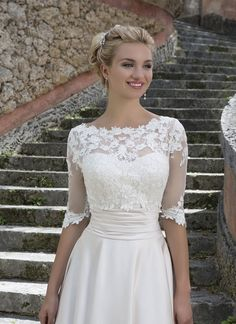 This Grace Kelly inspired ball gown features a beaded Sabrina lace bodice, satin cummerbund, and a full skirt with pockets. The stretch beaded lace jacket completes this refined look. https://www.sinceritybridal.com/wedding_dress/3877