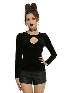 <p>Black velvet top with a keyhole accent on the front and lace-trimmed lace-up detailing on the back.</p>  <ul> 	<li>100% polyester</li> 	<li>Hand wash cold; dry flat</li> 	<li>Imported</li> 	<li>Listed in junior sizes</li> </ul>