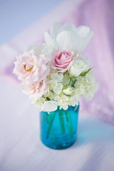 Hydrangea, pink rose, and tulip mason jar centerpiece | Captured by Belinda