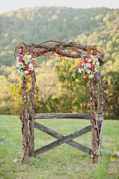rustic arch.. love love love this. This reminds of a wedding in west virginia. Beautiful.