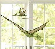 pterodaktyl na gumičke mávajúci krídlami