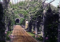 Rose and Pear arbor - lovely.  Finely Barrow Estate, Lake Forest, IL – Arbor between orchard garden and rose garden