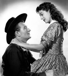 John Wayne, Gail Russell– Angel and the Badman ( I love this movie!  She was just precious and he was a tuff guy melting into her hands.)