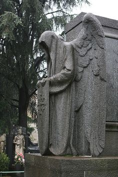 Milan cemetery milano cemetery - cimitero monumentale di milano       angel of death  angel head covered with hood