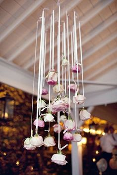 hang roses in the ceiling from satin ribbons