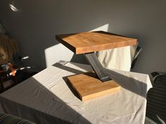 Stained and finished this wood and Metal end coffee table by zentia