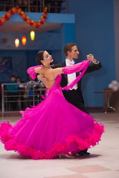 Pink ballroom dance dress, I also like the soft look hair.