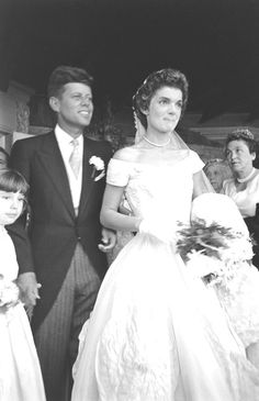 http://en.wikipedia.org/wiki/Jacqueline_Kennedy_Onassis Future US President John F Kennedy (1917 - 1963) and Jacqueline Kennedy (1929 - 1994) (in a Battenburg wedding dress) stand in front of St Mary's Church after their wedding ceremony, Newport, Rhode Island, September 12, 1953. (Photo by Lisa Larsen/Time & Life Pictures/Getty Images).   http://en.wikipedia.org/wiki/Wedding_dress_of_Jacqueline_Bouvier