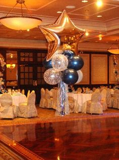 Centerpiece: I like the combo of gold, white flecked, and navy balloons.