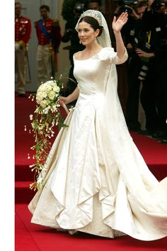 Princess Mary of Denmark paired her gown with a century-old crown at her May 2004 wedding to Crown Prince Frederik.   - MarieClaire.com