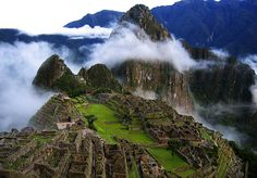 """Machu Picchu -  is an Inca site located 2,430 metres (7,970 ft) above sea level situated on a mountain ridge above the Urubamba Valley in Peru. Most archaeologists believe that Machu Picchu was built as an estate for the Inca emperor Pachacuti (1438–1472). Often referred to as """"The Lost City of the Incas"""", it is perhaps the most familiar icon of the Inca World."""