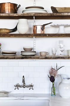 metrol tiles and reclaimed wooden shelves with a copper pan for a trend led colour pop