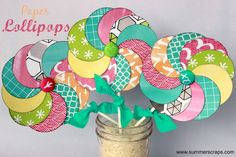 Do you love to make paper crafts? Then come and see my tutorial for Paper Lollipops in this fun Spring colored paper and bring some Spring into your home!!