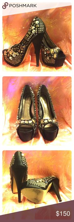 ZIGI NEW YORK BLACK SATIN JEWEL AND STUDDED SHOES This is a pair of Zigi New York black satin peep toe shoes, studded , crystals , and metal Jules encrusted with a 6 inch heel and 2 inch wedge, makes for a very elegant pair of shoes. ZIGI NEW YORK Shoes Heels