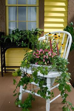 Turn an old wooden chair into a flower planter by cutting a hole in the seat to hold flower pots.