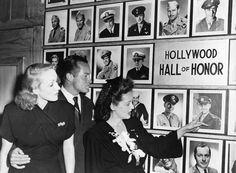 Bette Davis pointing out pictures of movie servicemen to Marlene Dietrich and Bob Hope in the Hollywood Canteen, 1943