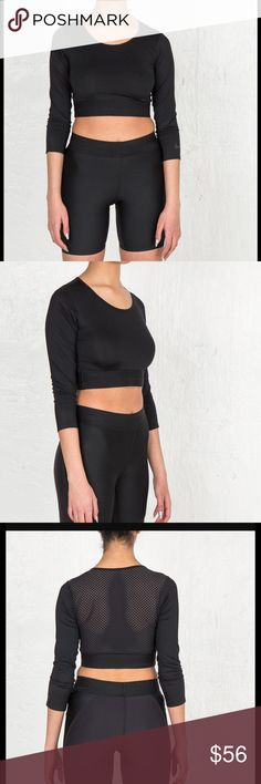 """Nike Lab 3/4 slv mesh back crop top NWT MSRP $110  No Noted Damage or Defects.   Pull On  Crop Length  Mesh Panel Back  3/4 Sleeve  Stretch  Body: 84% Polyester 16% Spandex   All Measurements Taken With Garment Lying Flat.  All Measurements Are Approximate.  Length 13.5"""" Sleeve 18""""  Bust (armpit to armpit) 15"""" Nike Tops Crop Tops"""