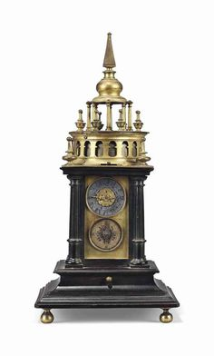 A GERMAN EBONY AND GILT-BRASS STRIKING TABLE CLOCK WITH ALARM  MID-17TH CENTURY, PROBABLY AUGSBURG